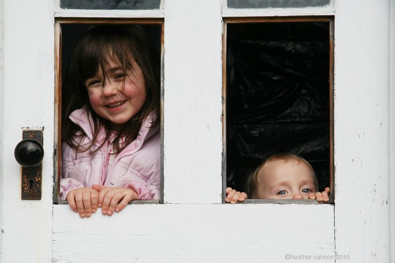 Children-peeking-out-of-window