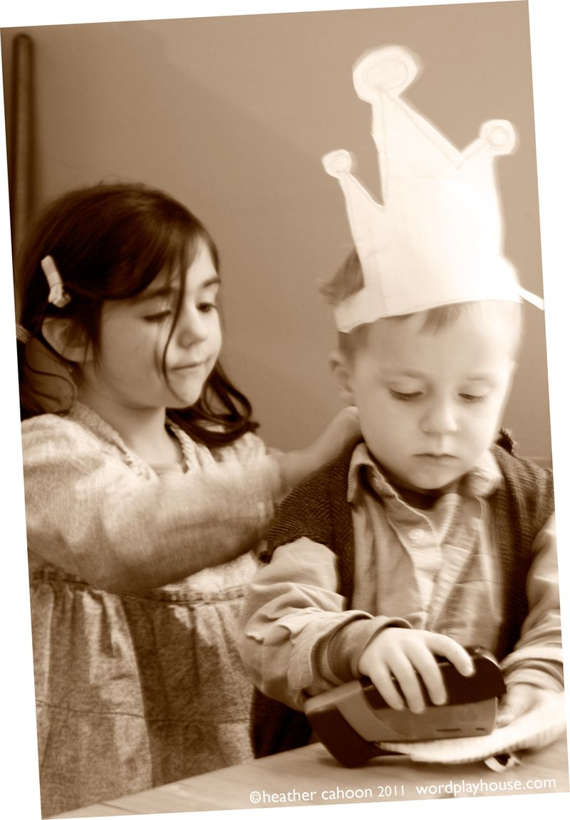 Girl-putting-prince-costume-on-boy