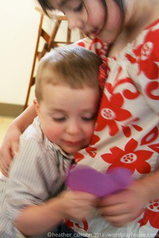 Children-hugging-and-paper-heart