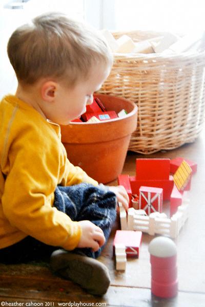 Boy-playing-with-barn-set