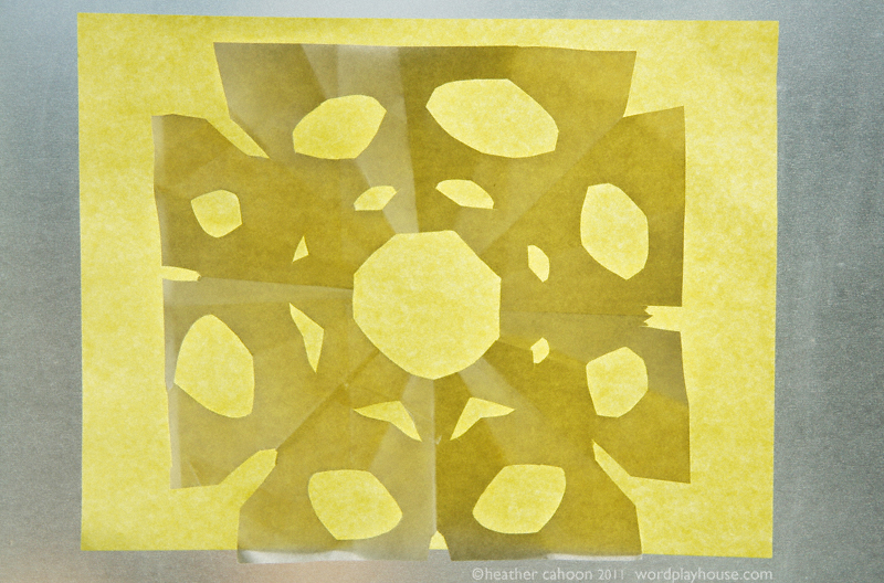 Yellow-paper-snowflake-on-window