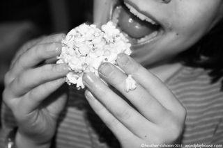 Girl-eating-popcorn-ball