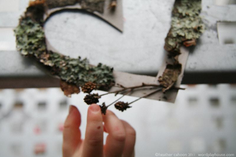 Boy-touching-dried-blackberries-wreath