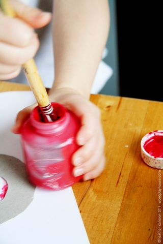 Child-painting-with-red-paint