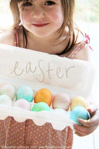 Girl-holding-colored-easter-eggs