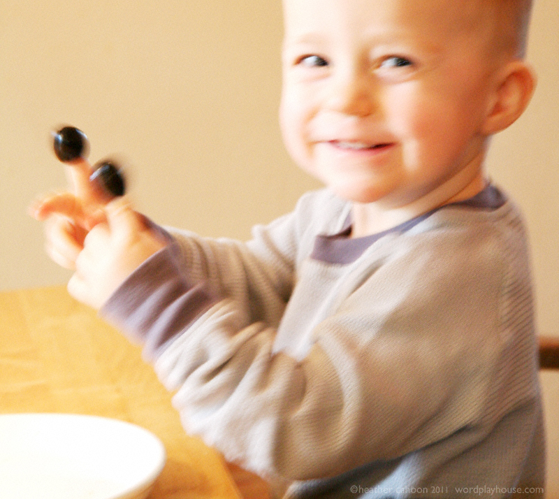 Boy-playing-with-olives*