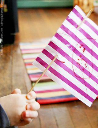 Boy-holding-paper-flag