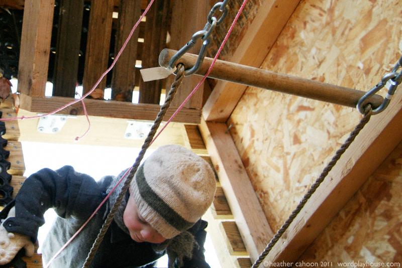 Boy-climbing-into-treehouse