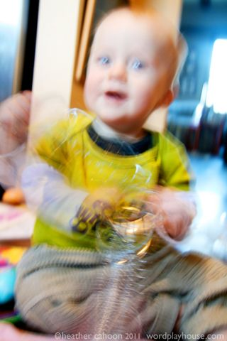 Baby-playing-with-slinky